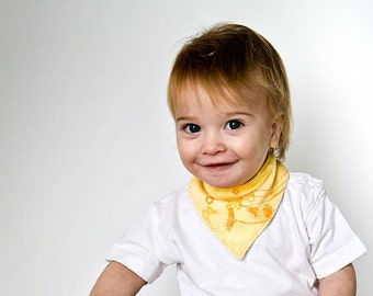 Baby Bandana Bib in yellow. Organic drooling Bib with golden flowers. Eco Friendly Bib.