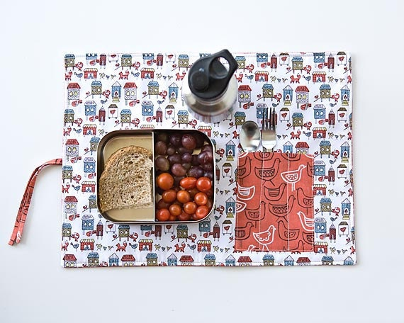 Orange placemat for kids with cutlery pocket. organic place mat with farm animals.
