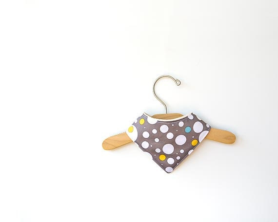 Eco friendly baby bib  with white polka dots on  grey color.