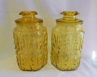 2 Vintage Hollywood Regency  Glass Canisters GOLD AMBER YELLOW Imperial Glass Atterbury Scroll