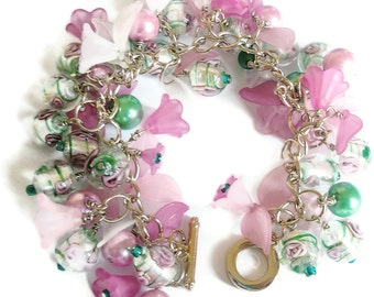 Charm Bracelet Champagne coloured Chain Lucite Flowers Pink Green Pearls and lamp-work Beads
