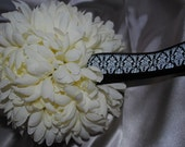 SHOP CLOSING SOON.. Six inch ivory pomander with black and white damask handle