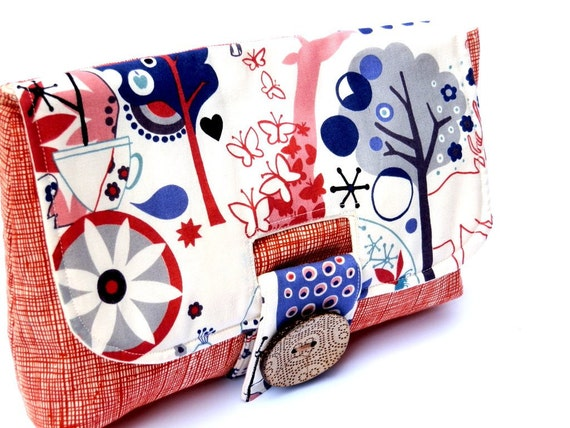 Clutch purse red blue and white with strap closure and large button