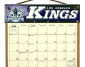 2016 CALENDAR - Los Angeles Kings Wooden  Calendar Holder filled with a 2016 calendar & a refill order form page for 2017.
