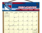 2016 CALENDAR - New York Rangers Wooden  Calendar Holder filled with a 2016 calendar & a refill order form page for 2017.
