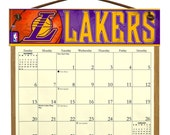 2016 CALENDAR - Los Angeles Lakers Wooden  Calendar Holder filled with a 2016 calendar & a refill order form page for 2017.