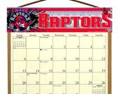 2016 CALENDAR - Toronto Raptors Wooden  Calendar Holder filled with a 2016 calendar & a refill order form page for 2017.
