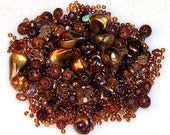 Iridescent Gold and Golden Brown Plastic Beads with Glass AB Bicones, Freshwater Pearls, and African Spacer Beads