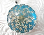 Snowflake Queen Anne's Lace Beneath Glass Atop Glowing Turquoise Background Pressed Flower Crown Pendant-Symbolizes Peace