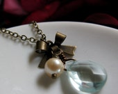 Vintage Inspired Necklace, Blue Teardrop Pendant, Antique Gold Brass, Bow Charm and Pearl - INNOCENCE
