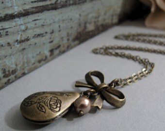 Dulce - Locket, Small Teardrop, Antique Gold Brass, Bow, Floral, Taupe Pearl, Vintage, 18 Inch Chain