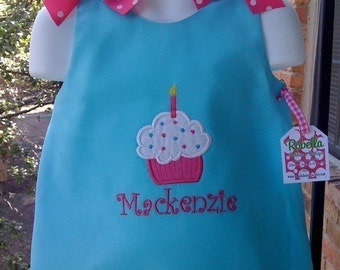 Custom Boutique Birthday Dress Turquoise with Hot pink bows.