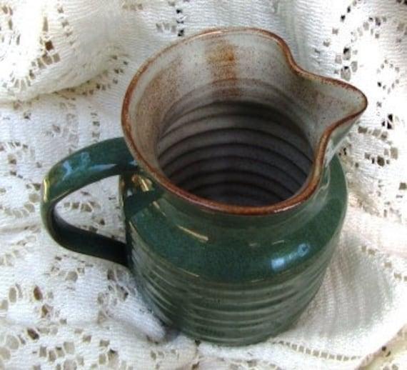 Green earthenware cream pitcher from Prima Pottery, Folkestone