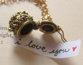 Secret message hinged charm necklace