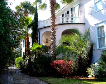 Balcony with Red Flowers and Inner Patio at Charleston South Carolina