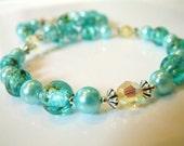 Reserved for Carolyn - Swarovski acqua snowflake bracelet