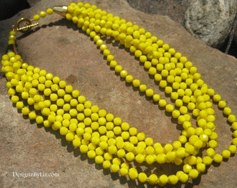 The Sunny Day, 7 strands of bright yellow opaque fauceted beads