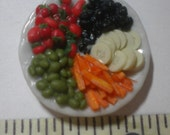 Vegetable deli tray, 1/12th scale, with carrot sticks, green and black olives, cucumbers, and cherry tomatos
