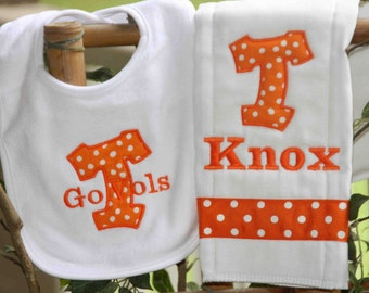 Orange polka dot bib and burpcloth set.