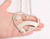 Vintage 1970s Silver Heart Necklace w/ Cutaway Rainbow Clouds & Birds Detail