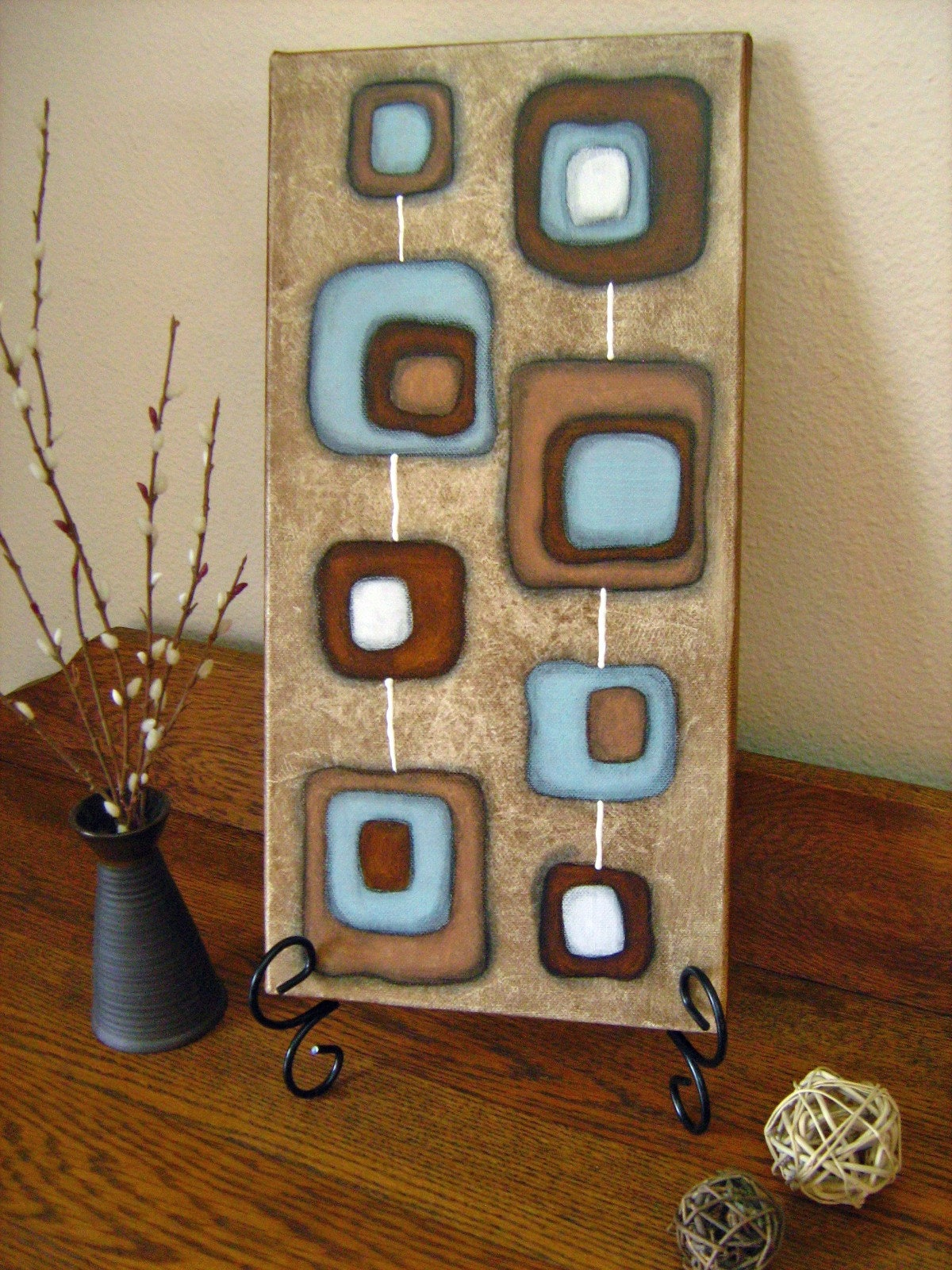 set of 2 blue and brown paintings on canvas