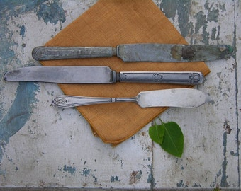 silver knives tarnished to perfection