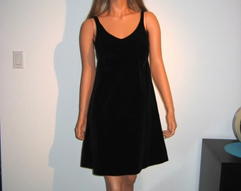 60's little black mini dress.  Vintage cotton velvet with built in bra.  Excellent condition.  Small