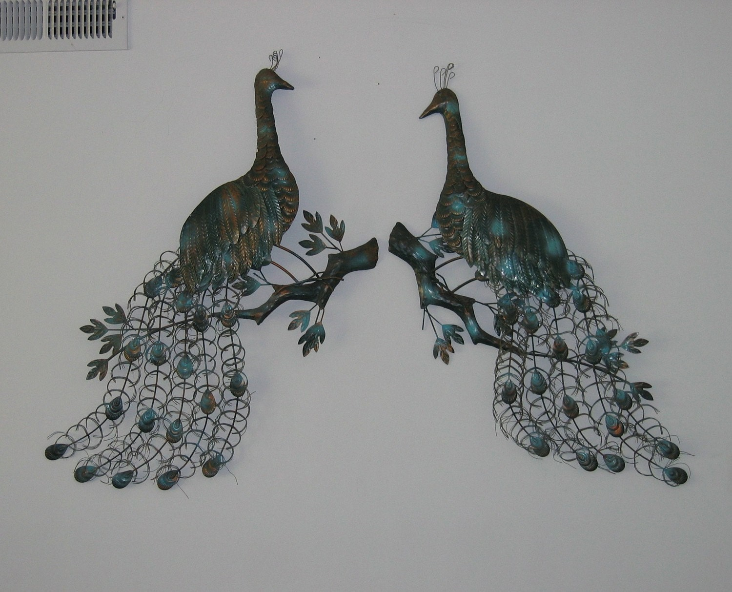 On hold for pmk5256 peacock metal wall sculpture art pair for Peacock wall art