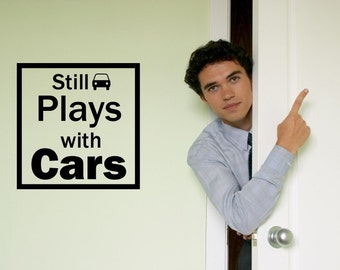 VINYL LETTERING DECAL-  Still Plays With Cars - 1001