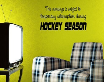 1007   - Vinyl Lettering - This marriage is subject to temporary interruption during hockey season.