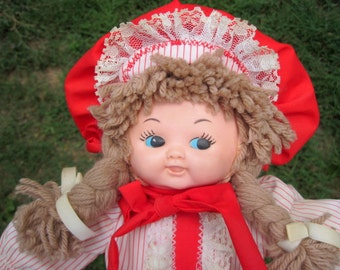 Handmade Child's Doll, Girl, child's toy, vintage handmade doll, handsewn, blond baby, yarn hair, red and white stripes, cherry red, braids