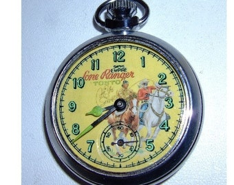 Free worldwide tracked shippingOld 1960s Lone Ranger and Tonto character dial pocket watch
