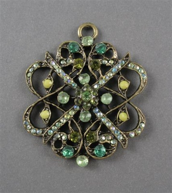 Pendant with Inlaid Green Glass Jewels