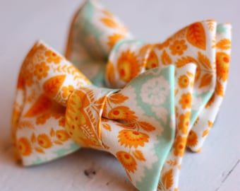 The Beau-  boy's amber paisley double stacked bow tie