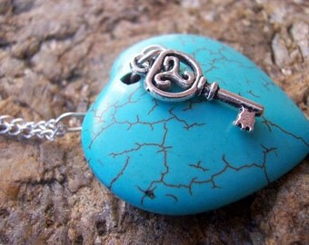 Turquoise howlite heart and key pendant