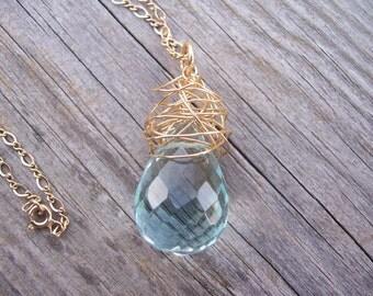 Blue quartz gold wire wrapped pendant