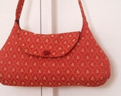 RESERVED Rust and gold shoulder bag in italian upholstery fabric with vintage button