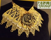 Gold Choker Lace Jabot with Jet Rhinestones, Winged Cabochon, and Charms