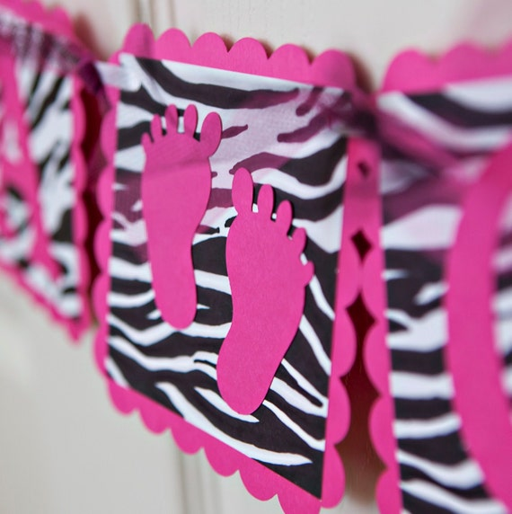 Baby shower banner pink zebra banner with footprints for Animal print baby shower decoration ideas