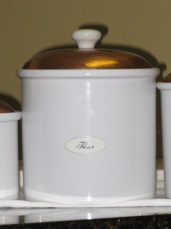 set of three ceramic white canisters w copper lids