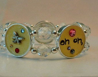 Stretch Bracelet, collage bracelet, Oh oh here comes trouble, fire polish beads, crystals, silver, yellow, beaded