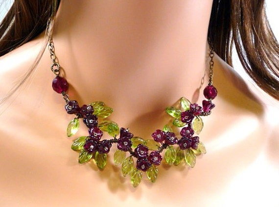 Necklace - wire wrapped, garnet red flowers, antiqued bronze, glass leaves, garden inspired