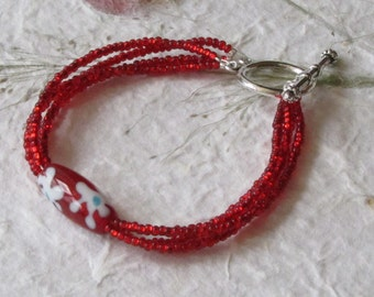 Multistrand, Red Seed Bead with Floral Focal Bead Bracelet