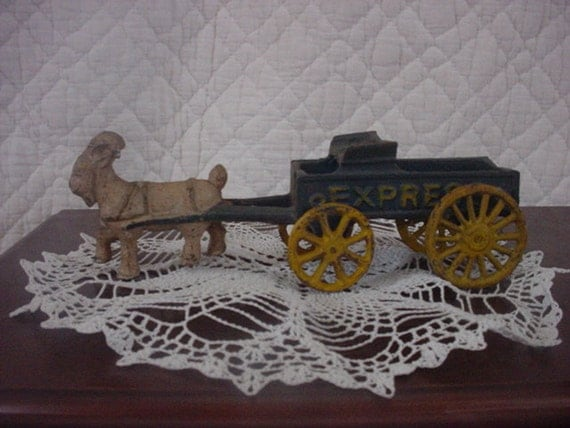 Cast Iron Toy Goat Pulling A Wagon