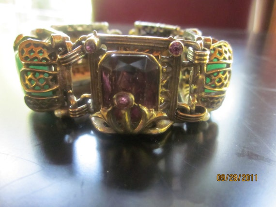 Art Deco brass bracelet with purple green glass stones and faux pearls