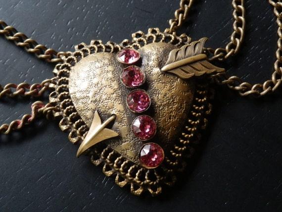 wonderful art deco brass festoon heart necklace with pink rhinestones