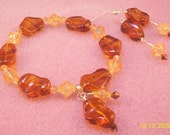 Autum Delight - Brown abstract Leaf shaped beads with Orange Crackle Bead Stretch Bracelet with Dangle and Earring Set