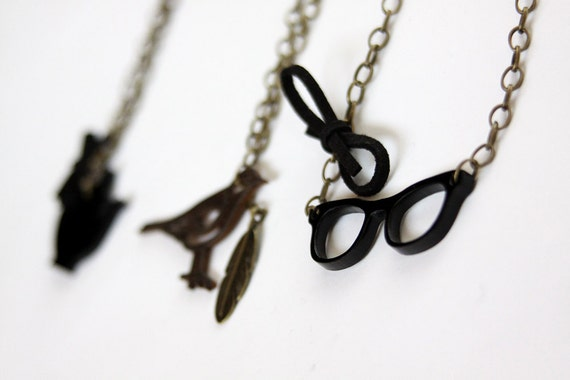 Laser Cut Geek Glasses necklace on antique gold plated chain.