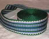 Green, blue, and white inkle woven trim