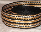 Black, burnished gold, and white hand-woven inkle trim